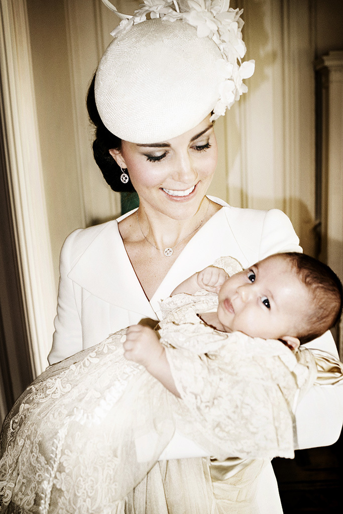 KING'S LYNN, ENGLAND - JULY 05: (EDITORIAL USE ONLY)   In this handout image supplied by Mario Testino/ Art Partner,  Catherine, Duchess of Cambridge and her daughter Princess Charlotte of Cambridge pose for a photo in the Drawing Room at Sandringham House after the christening of Princess Charlotte of Cambridge on the Sandringham Estate on July 5, 2015 in King's Lynn, England. (Photo by Mario Testino/ Art Partner via Getty Images) ***Terms of release, which must be included and passed-on to anyone to whom this image is supplied: USE AFTER 10/10/2015 must be cleared by Art Partner. This photograph is for editorial use only. NO commercial use. NO use in calendars, books or supplements. Use on a cover, or for any other purpose, will require approval from Art Partner and the Kensington Palace Press Office. There is no charge for the supply, release or publication of this official photograph. This photograph must not be digitally enhanced, manipulated or modified and must be used substantially uncropped.  Picture must be credited: copyright Mario Testino /Art Partner***