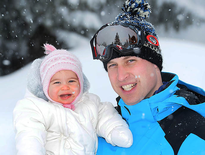 Britain's Prince William poses with Princess Charlotte as they enjoy a short private break skiing in the French Alps, Thursday March 3, 2016.  This is the first time the family of four have taken a holiday together. (John Stillwell/Pool via AP) NO COMMERCIAL USE