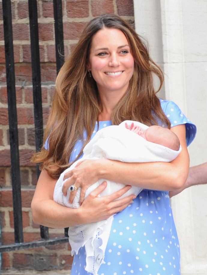LONDON, ENGLAND - JULY 22:  Catherine, Duchess of Cambridge depart The Lindo Wing with their newborn son at St Mary's Hospital on July 22, 2013 in London, England.  The Duchess of Cambridge yesterday gave birth to a boy at 16.24 BST and weighing 8lb 6oz, with Prince William at her side. The baby, as yet unnamed, is third in line to the throne and becomes the Prince of Cambridge.  (Photo by Ferdaus Shamim/WireImage)