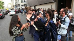The Hadid sisters, Bella and Gigi, are seen leaving the Max Mara fashion show in Milan. After posing for pictures with some fans the stunning duo made their way to their car when a fan grabbed Gigi then pick her up and carried her against her will. The young model decided to quickly fight back and sent the crazy man running! 22 September 2016. Please byline: Best Image/Vantagenews.com